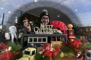 Christmas wonderland - in July. Danny Harb, owner of st.derby cafe in Pascoe Vale, with his window display.