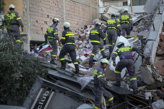 Rescuers at a collapsed building after the 6.4-magnitude earthquake in Durres, western Albania.