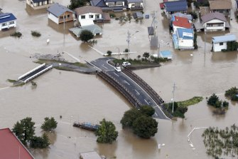 A road in Nagano, central Japan, submerged after the Chikuma River overflowed due to Typhoon Hagibis.