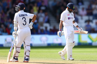 Virat Kohli heads back to the pavillion after being caught by Joe Root.