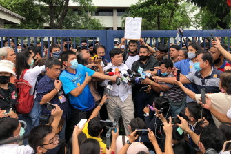 "Protest leader Parit ""Penguin"" Chiwarak outside the criminal court in Bangkok after his release on bail on August 15."