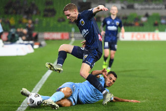 City's Andrew Nabbout tackles Kye Rowles.