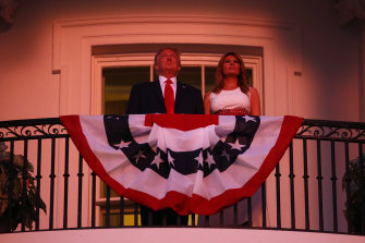 "President Donald Trump and first lady Melania Trump stand on the Truman Balcony of the White House as they watch a fireworks display during a ""Salute to America"" event on July 4."