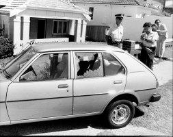 A police officer stands guard over   slain consular bodyguard Engin Sever's car on December 17, 1980