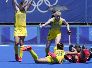 Australia midfield Renee Taylor (21) and midfield Amy Rose Lawton (4) celebrate after Grace Stewart (30) scored on Spain during their match.