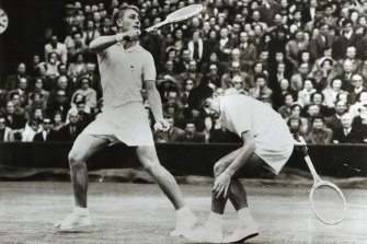 Lew Hoad and Ken Rosewall playing against Tony Trabert and Vic Seixas in the semi-final doubles at Wimbledon, 1954.