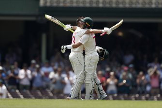 Marnus Labuschagne celebrates with Tim Paine after reaching his double century at the SCG.