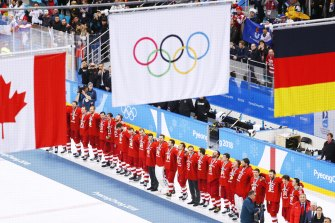 White flag: Russian athletes were forced to celebrate their men's ice hockey gold medal under the Olympic banner at the 2018 Winter Olympic Games.
