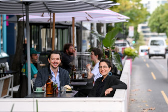 Yarra mayor Gabrielle de Vietri and Gertrude Street resident Peter 'PK' Kaylor make use of the parklets at Archie's All Day cafe on Monday afternoon.