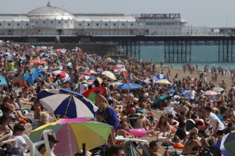 Beachgoers flocked to Brighton Beach on Friday as the temperature hit 35 degrees, the hottest day of the year.