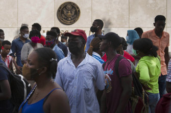 Haitians outside the U.S. Embassy  amid rumors on radio and social media that the US will be handing out exile and humanitarian visas.