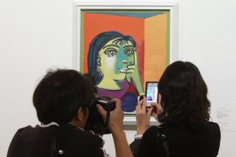 Capturing photographic memories of one of Picasso's portraits of Dora Maar.