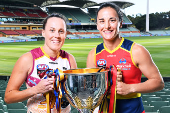 Lions captain Jade Ellenger and Adelaide Crows' Angela Foley before the AFLW grand final at Adelaide Oval in April.