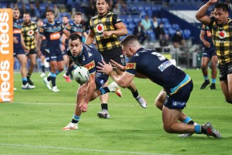 Rookie Beau Fermor scores the match-winning try for the Titans against the Warriors on Friday night.