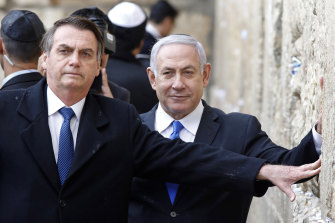 Brazilian President Jair Bolsonaro (left) and Israeli Prime Minister Benjamin Netanyahu touch the Western wall, the holiest site where Jews can pray, in the Old City of Jerusalem, in April this year.