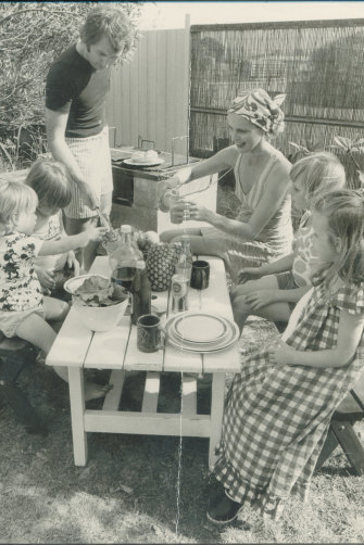 The young Bryce family in the 1970s, eating al fresco.