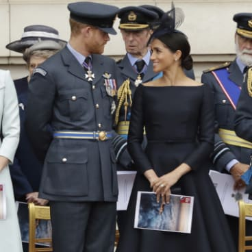 Markle wearing a Dior gown at a ceremony before the flypast of Royal Air Force aircraft.