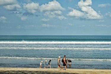 Tourists at Kuta beach.