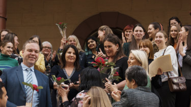 MPs celebrate with abortion advocates after the bill was passed.