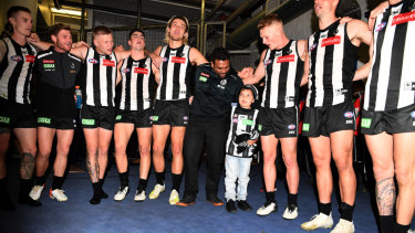 Well played: Collingwood gave young cancer sufferer Kyron McGuire the night of his life in their win over Port Adelaide.
