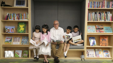 John Vallance, the NSW State Librarian, with the Wu siblings, Ethan, Nathan, Macayla and Allyson, in the new Children's Library.