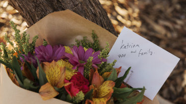 Flowers left outside the Osmington property where the bodies of seven people were found.