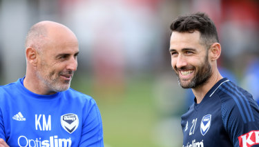 Cool, calm and collected Carl Valeri sharing a laugh with Victory coach Kevin Muscat.
