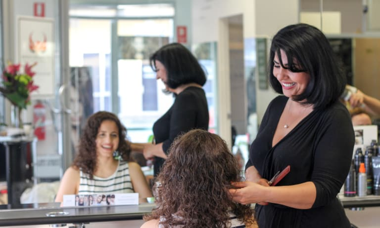 Azita Abdollahian always wanted to do both hairdressing and counselling.