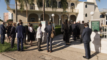 Members of the legal profession and Muslim community arrive at Auburn Gallipoli Mosque.