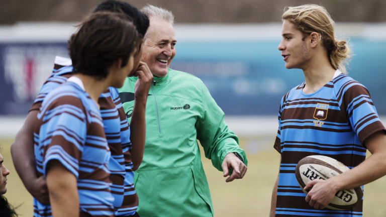 Happy to be back: David Campese shares some wisdom and a few laughs with players from the First XV at Sydney Boys' High