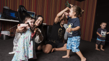 Family man: Rob and Sofia Whittaker play with their kids at home just beyond the south western fringe of Sydney.