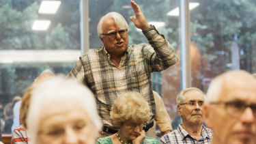 An attendee speaks out against changes to franking credits at the public hearing at Chatswood, Sydney.