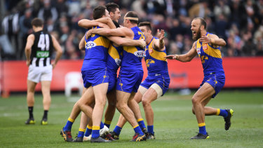 West Coast players were happy with their 2018 premiership but the price for fans to get to Melbourne was less smile-inducing.