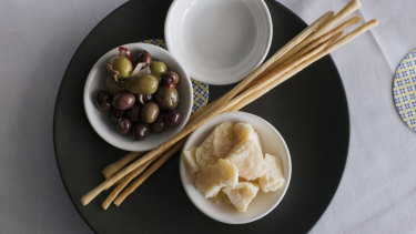 A classic Italian starter – marinated olives, Parmigiano reggiano and grissini.