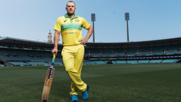 Australian captain Aaron Finch showing off his team's 1986 replica one-day playing kit that will be worn on Saturday at the SCG.