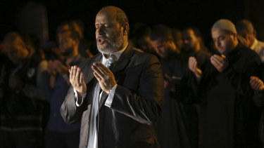 Hamas leader Khalil al-Hayya, leads an evening prayer  marking the first eve of the holy fasting month of Ramadan, outside the tents of the protest camp near the Israeli border east of Gaza City.