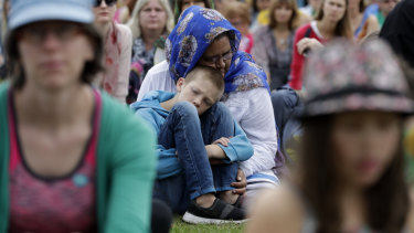 A woman embraces a boy at a March 23 'March for Love' following the mosque attacks in Christchurch.
