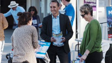 Dave Sharma and his wife Rachel at a pre-polling booth in Wentworth on Tuesday.