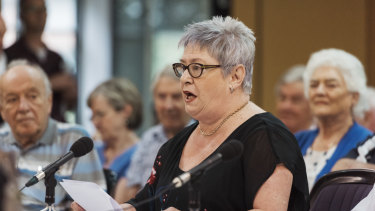 Maureen Chuck, 63, was booed when she said the money saved could fund public schools.