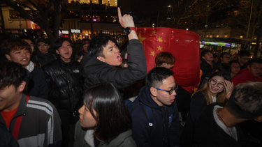 A number of pro-China demonstrators at a pro-Hong rally at Melbourne State Library.
