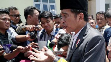 "Joko ""Jokowi"" Widodo speaks to journalists at an Islamic microfinance bank in Balaraja, Banten province."