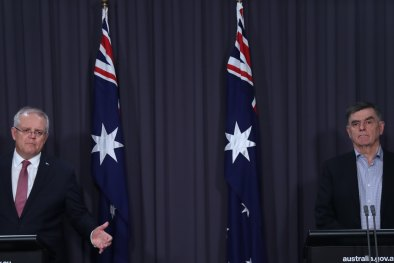 Prime Minister Scott Morrison while Chief Medical Officer Brendan Murphy on Sunday night