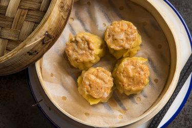 Full steamer of kimchi siu mai