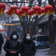 Chinese women walk in a usually busy shopping and tourist area during the Chinese New Year holiday in Beijing.  Concerns over the virus wiped $29b from the ASX200 on Tuesday.