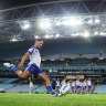 A rugby league match is being played in front of an empty stadium in Sydney on March 19 as Brendon Wakeham of the Bulldogs takes a conversion attempt.
