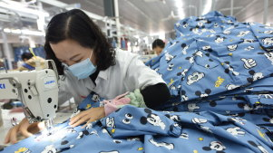 China's manufacturing activity continues to grow but at a slower pace.