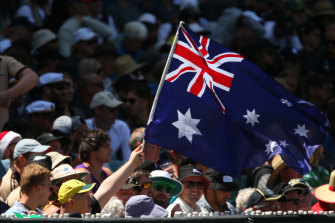 An Aussie fan waves the flag