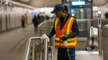 Railings are disinfected at a New York subway station.