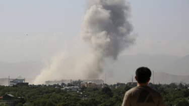 Smokes rises after a huge explosion in Kabul, Afghanistan, on Monday.