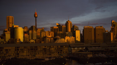 Golden dusk lights hits the CBD, as seen from the Herald's Pyrmont office.